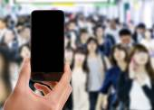 Hand holding mobile smart phone — Stock Photo