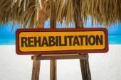 Rehabilitation sign with beach — Stock Photo