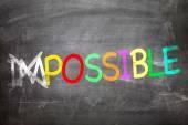 Impossible written on a chalkboard — Stock Photo