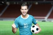 Soccer fan celebrates in blue t-shirt — Stock Photo