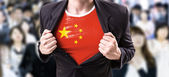 Businessman stretching suit with Chinese flag — Stock Photo