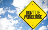 Don't Die Wondering sign — Stock Photo