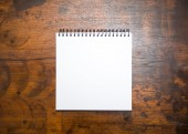 Blank notepad on wood table — Stock Photo