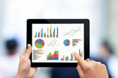 Hand holding digital tablet with analyzing graph — Stock Photo