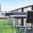 Wicker chair  and a table on an open terrace with blue sky — Stock Photo #71781157