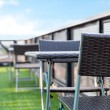 Wicker chair  and a table on an open terrace with blue sky — Stock Photo #71781175