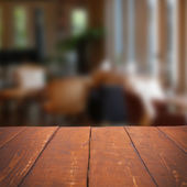 Empty wooden table and blurred cafe background — Stock Photo