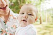 Close-up cute happy baby with her father outdoors in spring park — Stock Photo