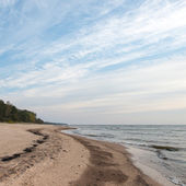 Shoreline of Baltic sea beach with rocks and sand dunes — Stock Photo
