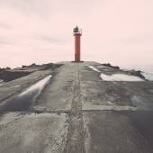 Breakwater in the sea with lighthouse on it. Vintage. — 图库照片