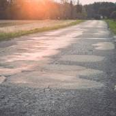 Wet asphalt road with sun reflections. Vintage. — Stock Photo