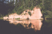 River with reflections in weater and sandstone cliffs. Vintage. — 图库照片