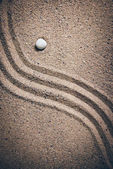 Zen garden sand waves and rock sculptures. Retro grainy film loo — Stock Photo