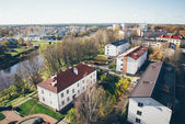 Small town panoramic view from above in the autumn. Retro grainy — Stock Photo