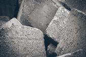 Small pebble rock background texture. Retro grainy film look. — Stock Photo