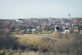 Small town panoramic view from above in the autumn. Retro grainy — 图库照片
