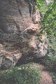 Sandstone cliffs with inscriptions - retro, vintage — Stock Photo