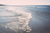Icy sea beach with first ice pieces - retro, vintage — Stock Photo