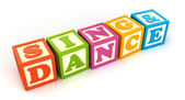 Building blocks  word sing and dance — Stock Photo