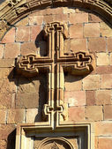 Stone cross on the wall of the temple Noravanq — Stock Photo