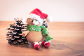 Christmas Bear and pine cones — Stock Photo