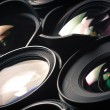 Set of DSLR lenses, different sizes and reflections. Side view. — Stock Photo #58510721