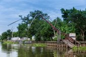 Old Fishnet in Thai style house next to river — Stok fotoğraf