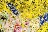 желтые и синие воды капли фон — Стоковое фото