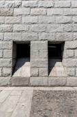 Stone wall with two window — Stock Photo
