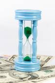 Sandclock on bank note represent money grow over time — Stock Photo
