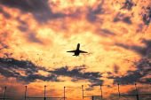 Jetliner aircraft on flight at sunset, dramatic sky — Stock Photo
