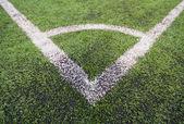 Artificial turf soccer field, a corner marker line — Stock fotografie