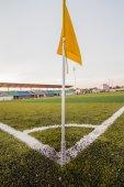 Artificial turf soccer field, a corner marker line — Stock Photo