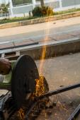 Worker are cutting steel by abrasive wheel cutting machine — Stock Photo