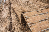 Track of a tractor on plowed field — Foto Stock