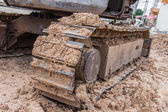 Foot of tractor in construction plant — Foto Stock
