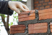 Building brick block wall on construction plant — Stock Photo