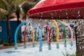 Water dripping from a toy Umbrellas — Stock Photo