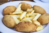Croquettes with fries — Stock Photo