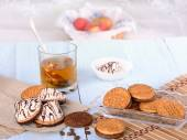Biscuits with tea and sweets — Stock Photo