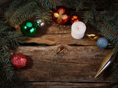 Christmas toys with tree branches burning candle — Foto de Stock