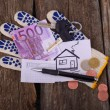 Five hundred euros painted house and the keys on the glove for — Stock Photo #60281377
