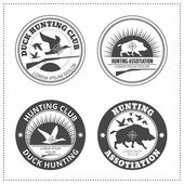 Set of vector hunting club emblems with a wild hog and a wild du — Stock Vector