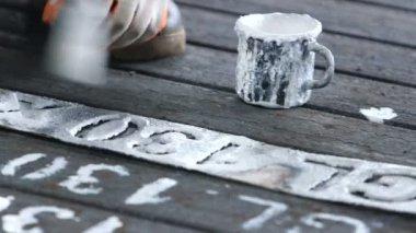 Workers  writing id numbers on steel blocks — Stock Video