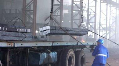 Workers transfer steel blocks — Stock Video