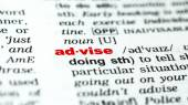 Word advise in dictionary — Stock Photo