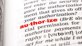 Word authorize in dictionary — Stock Photo