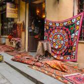 Old carpets in the street market — Stock Photo