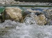Stones over a running stream — Stock Photo