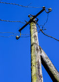 Old column with electric wires — Stock Photo